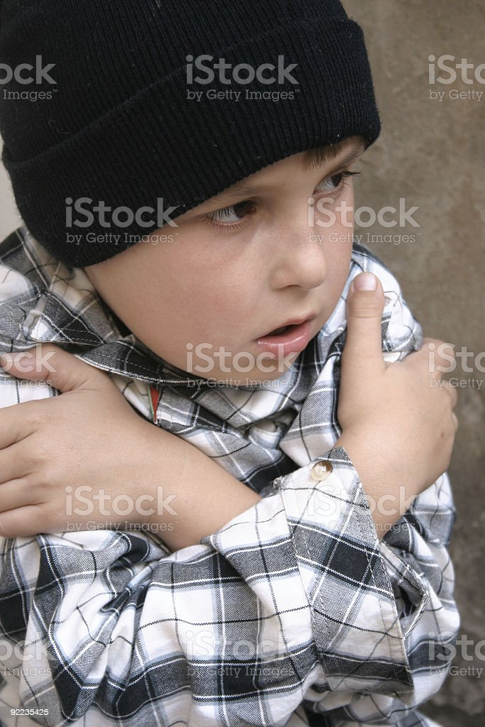 Young boy shivering cold and lonely royalty-free stock photo