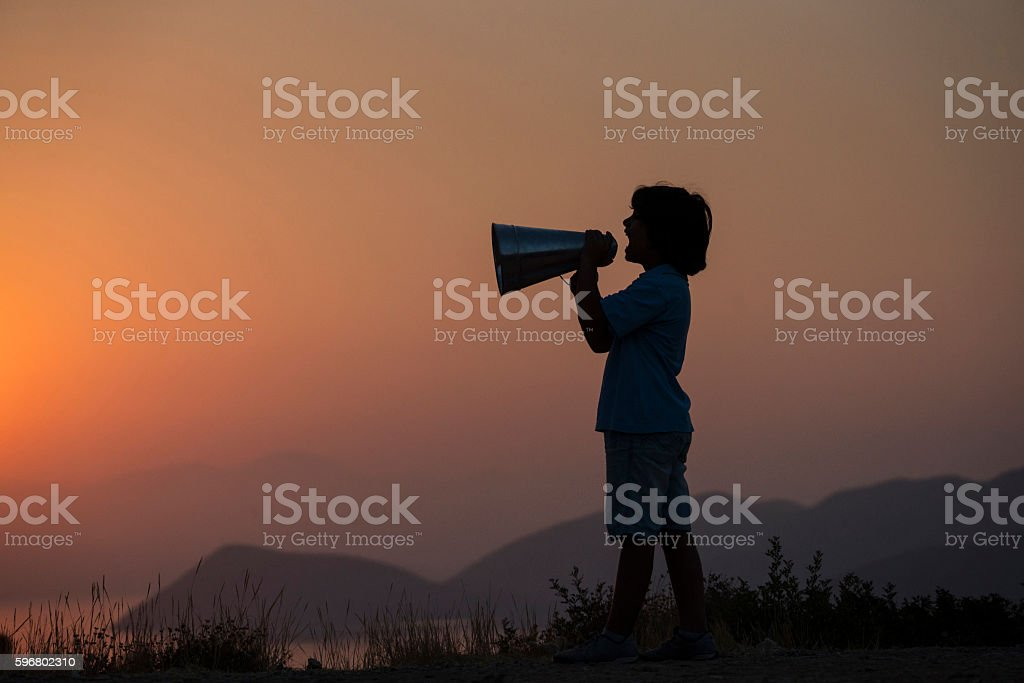 Young boy shouting in megaphone