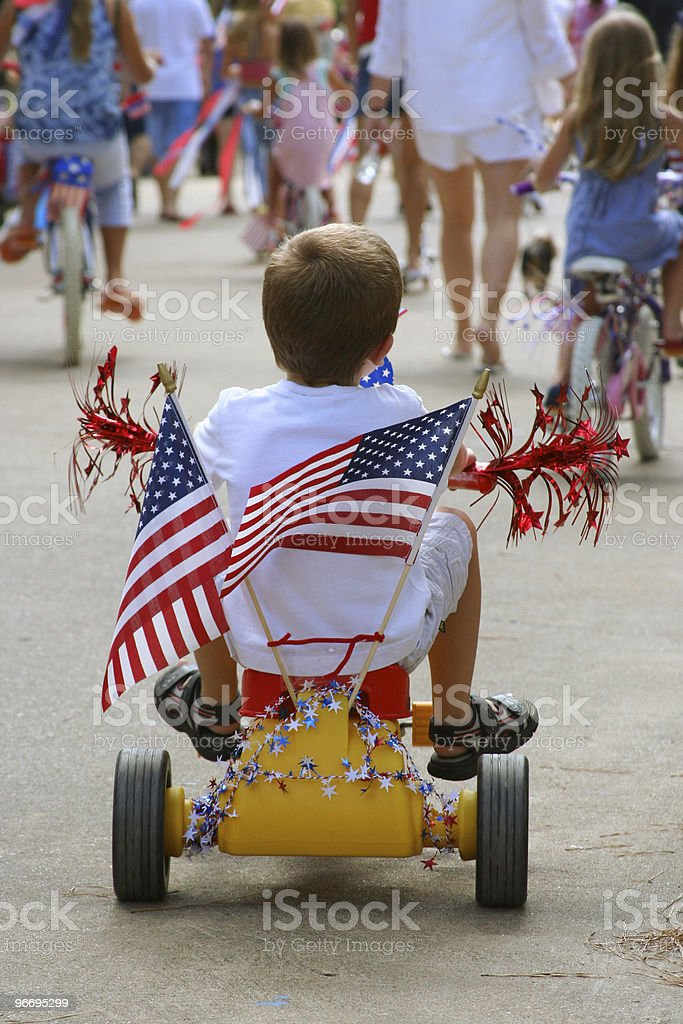 Young boy shows patriotism in 4th of July Parade stock photo