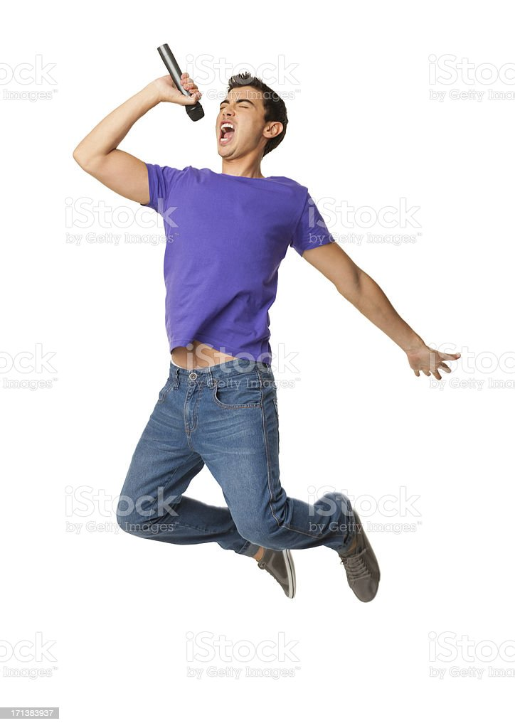 Young Boy Singing In Mid-air - Isolated stock photo