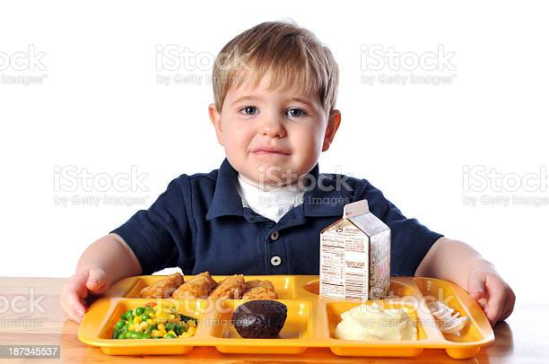 Young boy sitting at a table with his school lunch picture id187345537?b=1&k=6&m=187345537&s=612x612&h=steq5u3kbxs0ghahzdccq2mxp4d1eqjnv5lhyiedtjo=