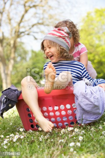 954356678istockphoto Young Boy Sitting In Laundry Basket 177546140