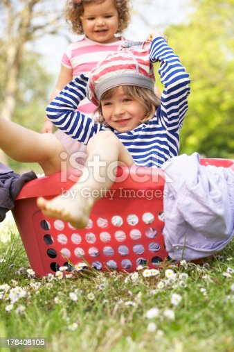 954356678istockphoto Young Boy Sitting In Laundry Basket 178408105