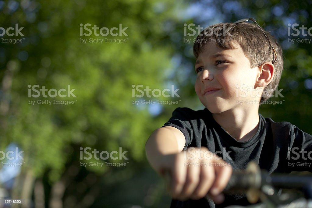 Young boy sitting on bike royalty-free stock photo