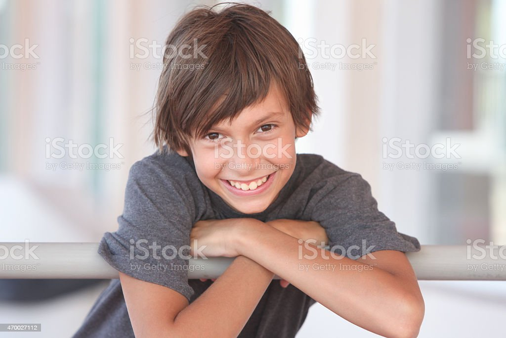 Young boy smiling at camera portrait stock photo