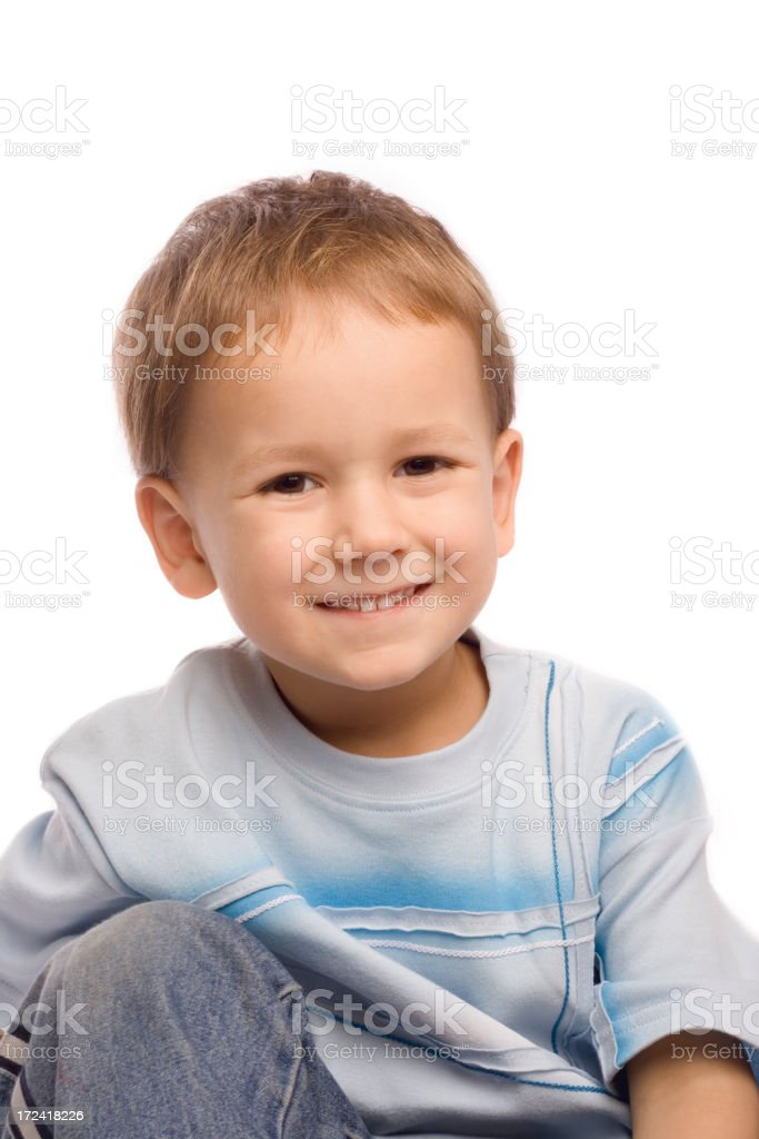 Young boy smiling on white background royalty-free stock photo