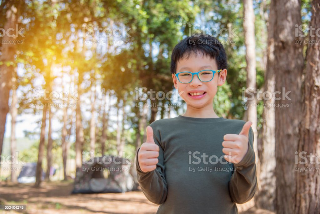 Young boy smiling outdoor stock photo