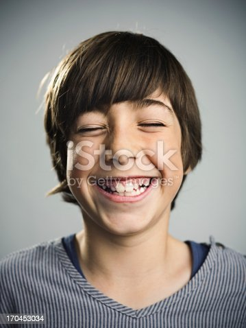 istock Young boy smiling 170453034