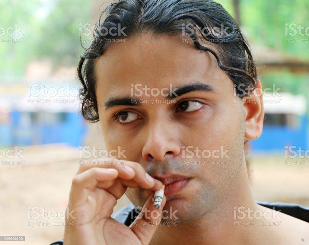 Young Boy Smoking stock photo