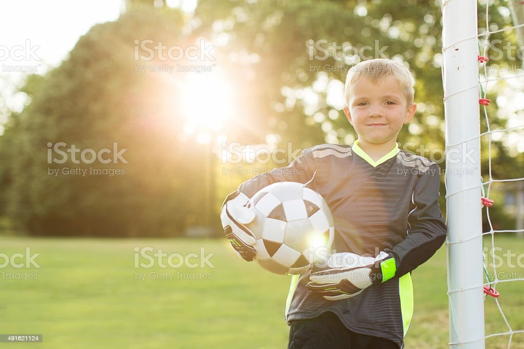 Young Boy Soccer Goalie Stands at Goal stock photo