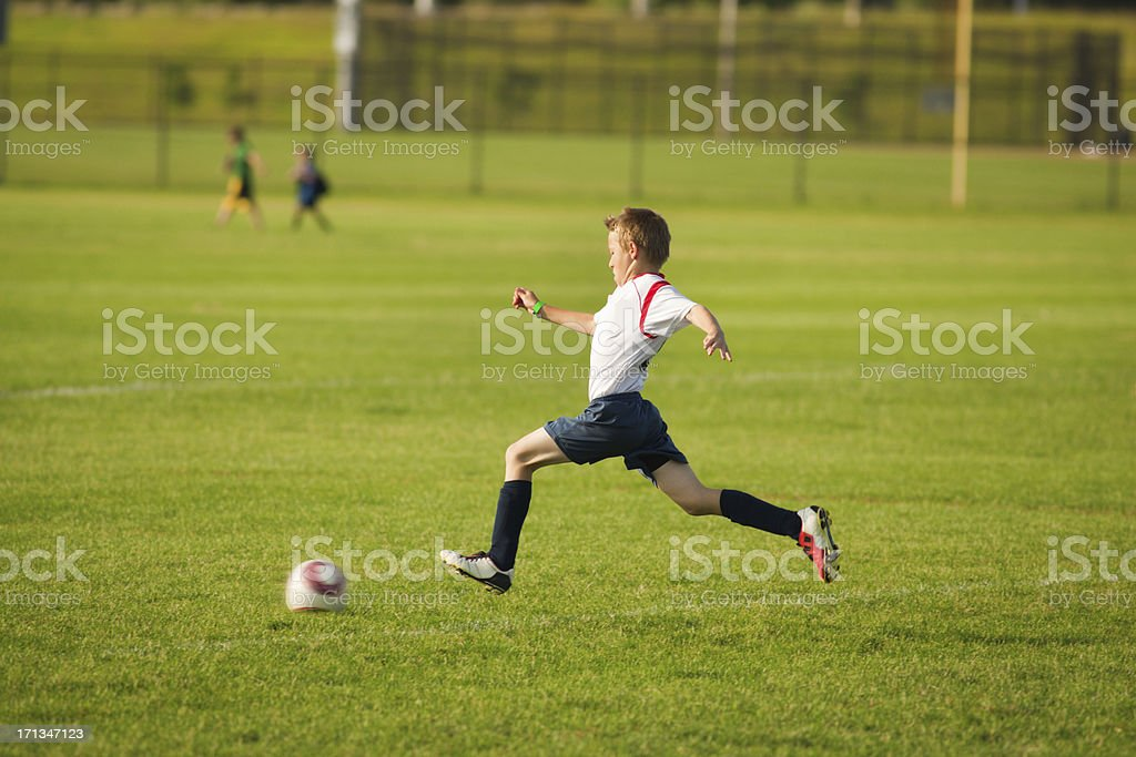 Young Boy Soccer Player Approaching the Goal with Ball royalty-free stock photo