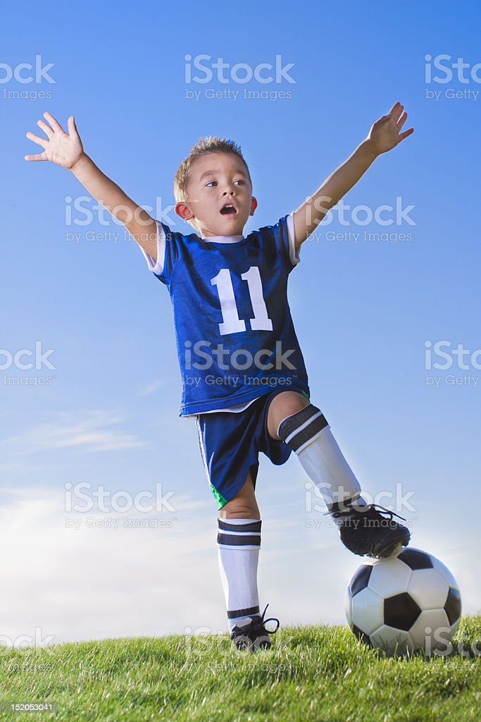 Young Boy soccer player celebrating stock photo