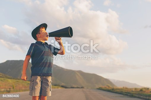 istock Young Boy Speaks through Megaphone 842663400