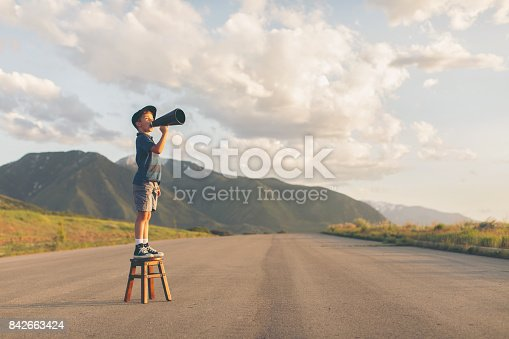 istock Young Boy Speaks through Megaphone 842663424