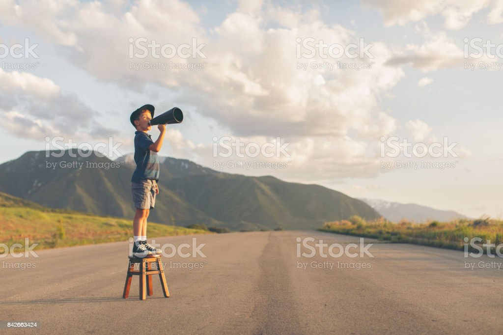 Young Boy Speaks through Megaphone stock photo