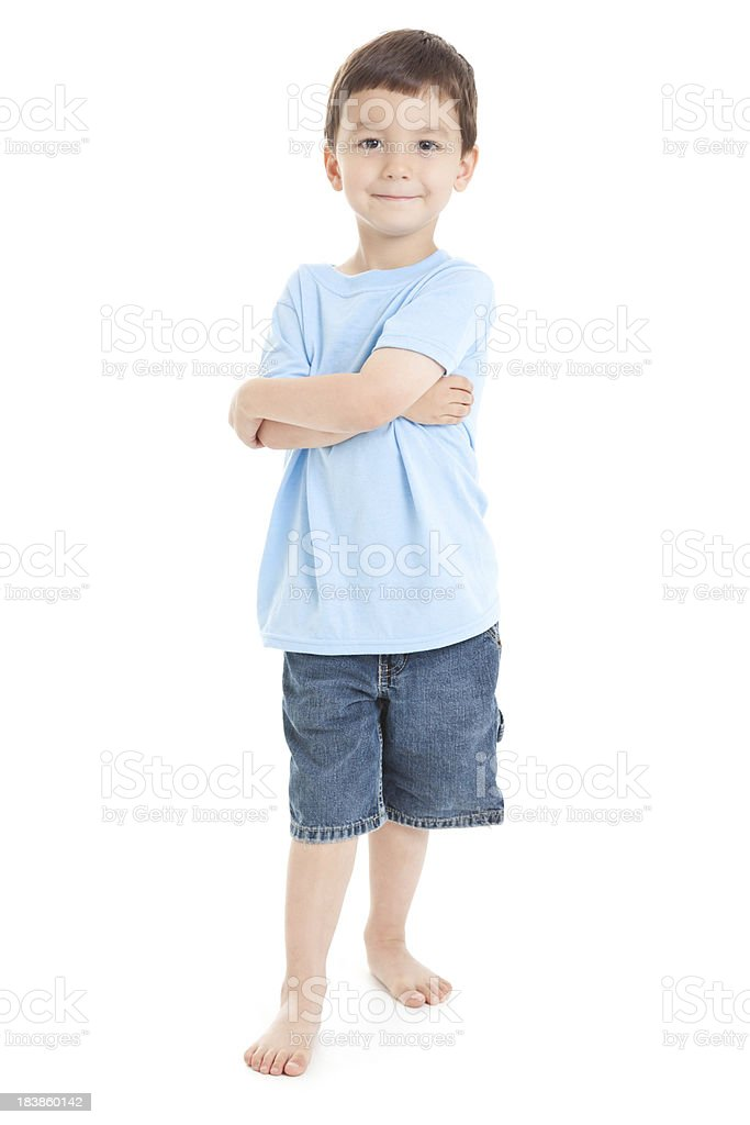 Young Boy Standing With Arms Crossed White Background