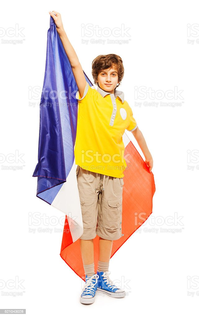 Young boy standing with French flag stock photo