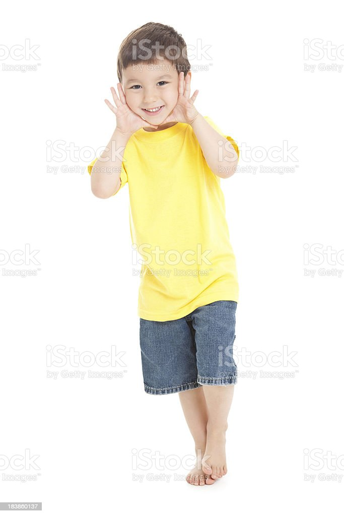 Young Boy Standing With Hands to Face, White Background stock photo