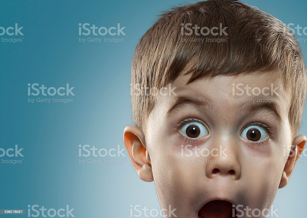 young boy staring stock photo