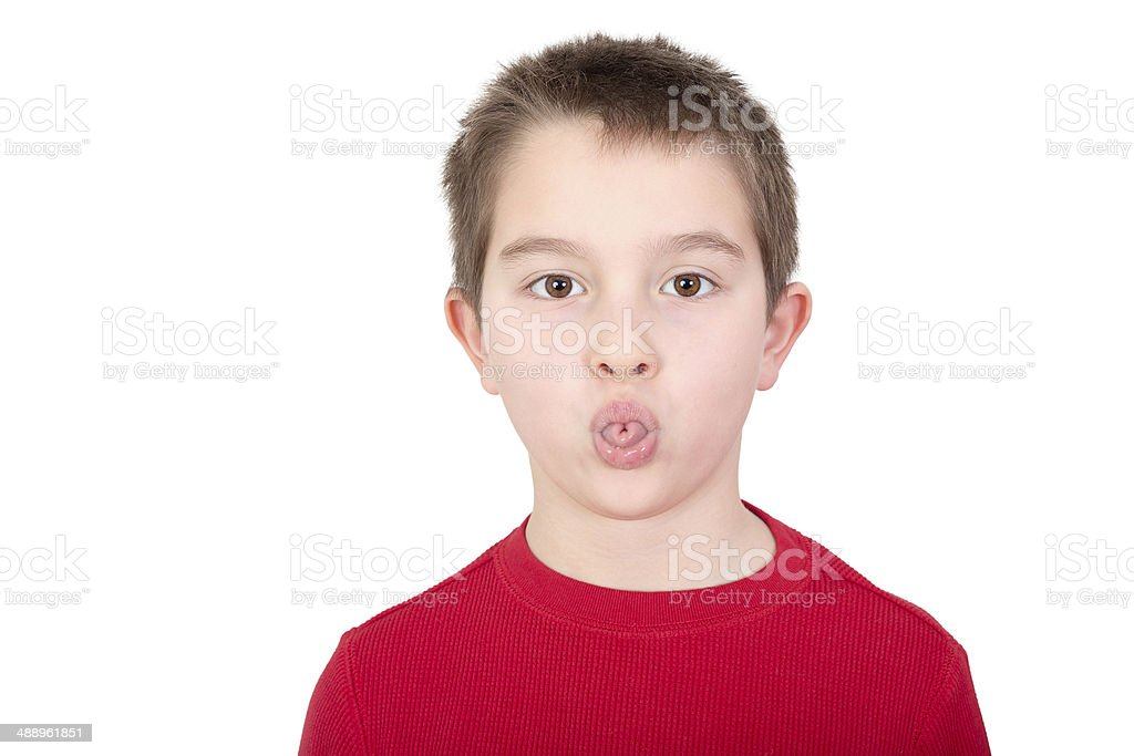 Young boy sticking out his tongue stock photo