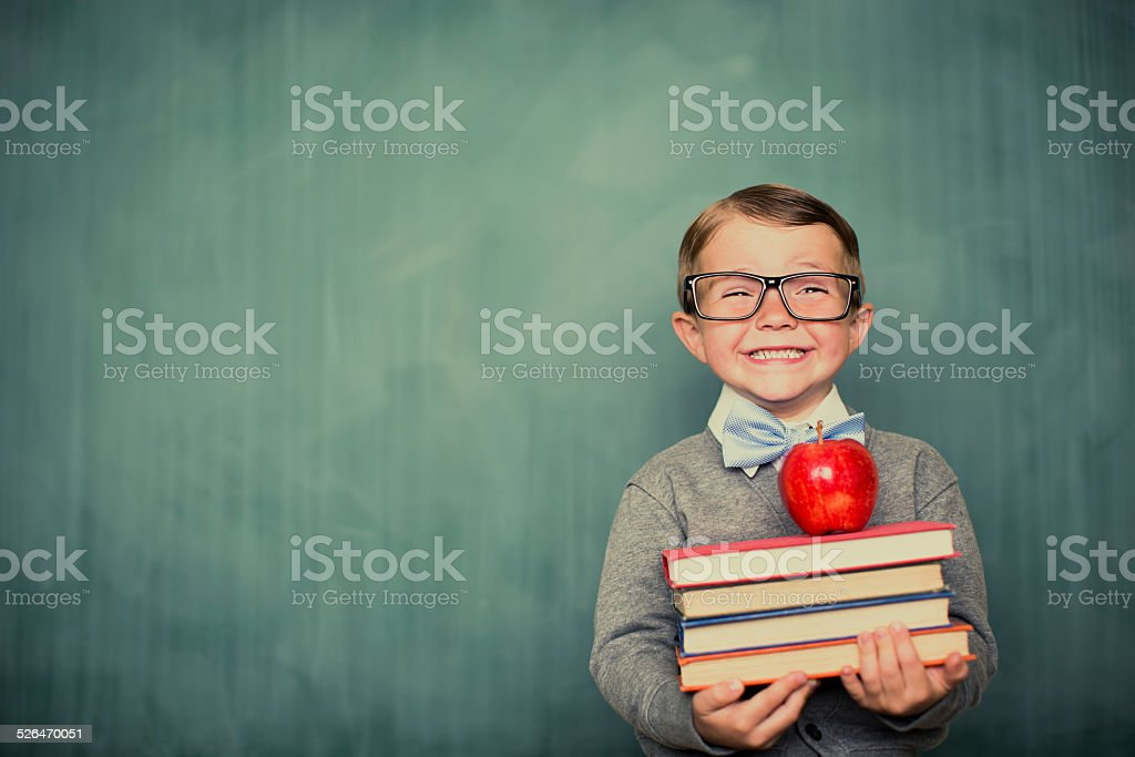 Young Boy Student Dressed as Nerd Holding Books stock photo