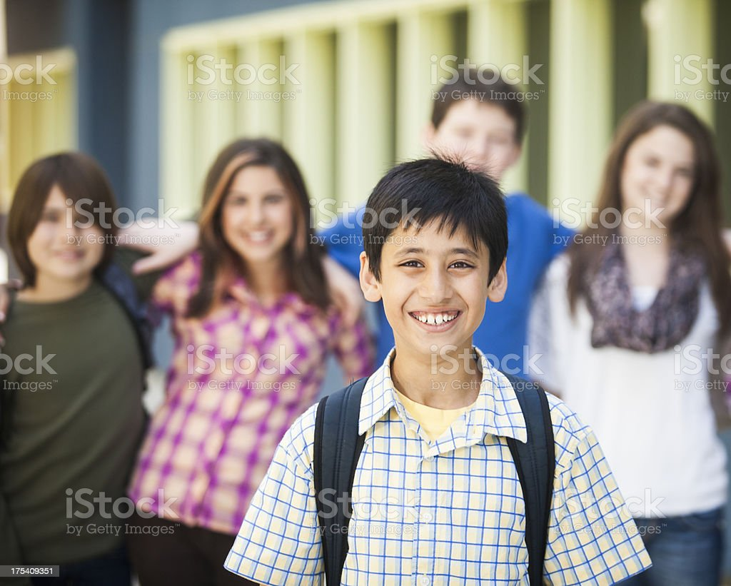 Young Boy Student with Friends in Background royalty-free stock photo