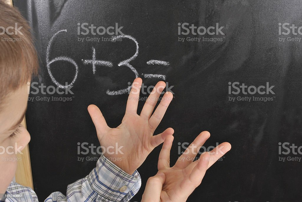 Young boy studying mathematics at the primary school stock photo