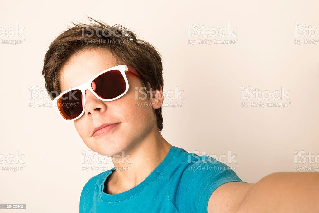 Young boy take a selfie stock photo
