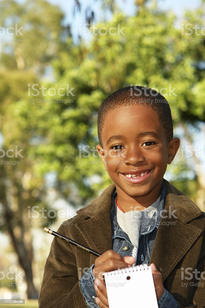 Young Boy Takes Note Vertical stock photo