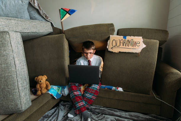 Young Boy Teleworking from Home stock photo