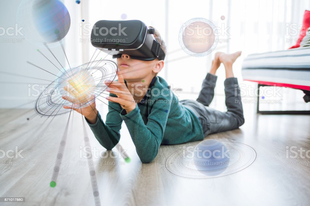 Young boy testing Virtual and augmented Reality stock photo