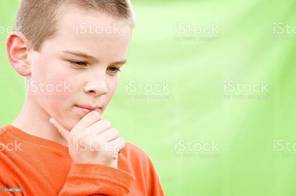 Young Boy Thinking on Green Background royalty-free stock photo