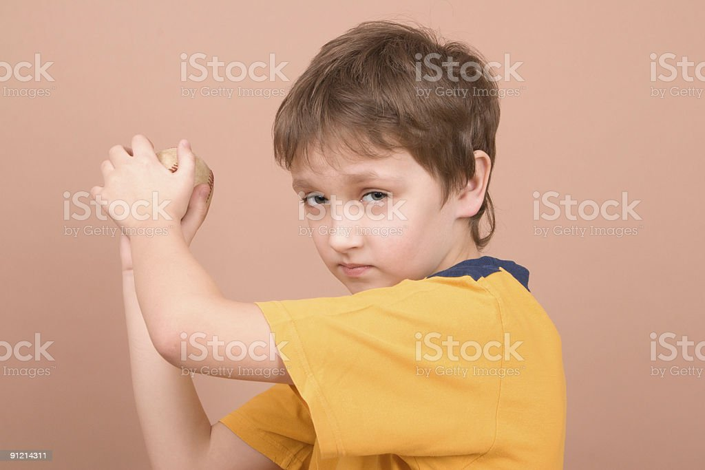 Young boy throwing a ball royalty-free stock photo
