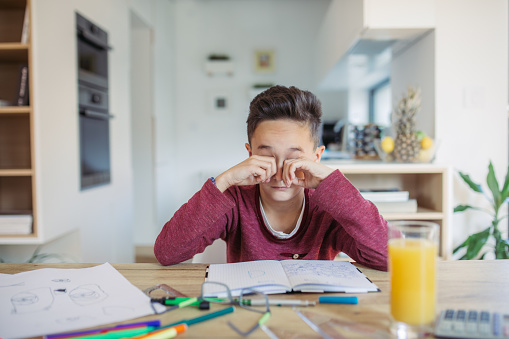 Young Boy Tired Of Doing Homework Stock Photo - Download Image Now