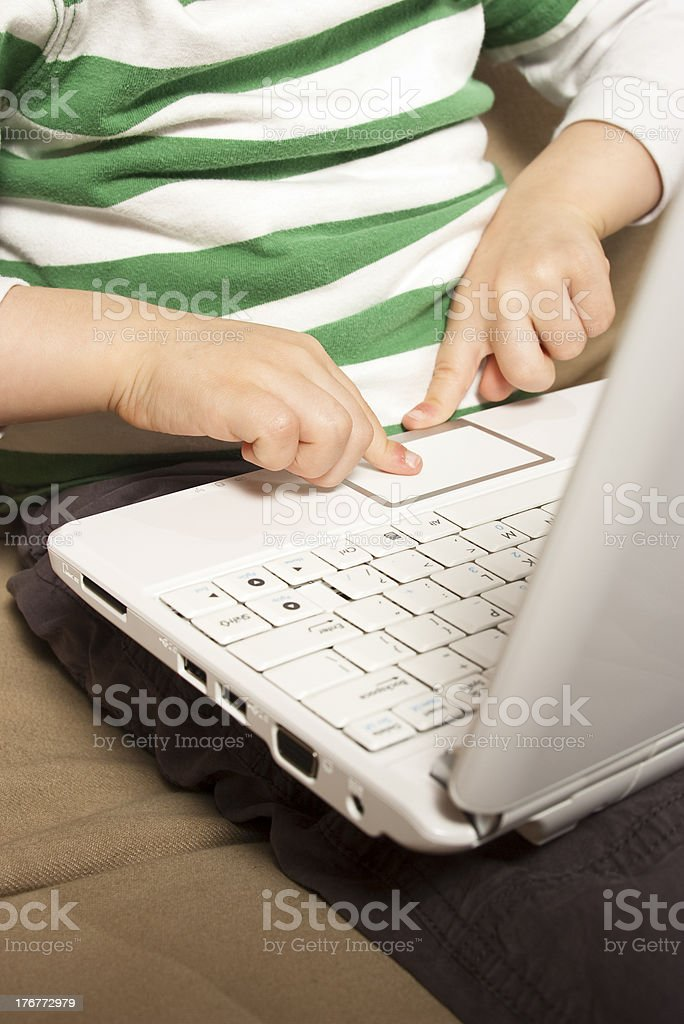 Young boy uses touchpad on NetBook royalty-free stock photo