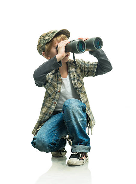 young boy using binoculars on white background - binocular boy bildbanksfoton och bilder