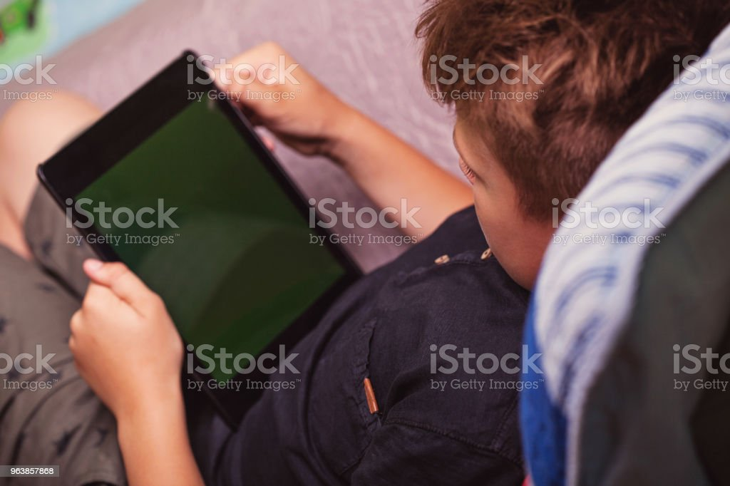 Young Boy Using Digital Tablet - Royalty-free Blank Screen Stock Photo