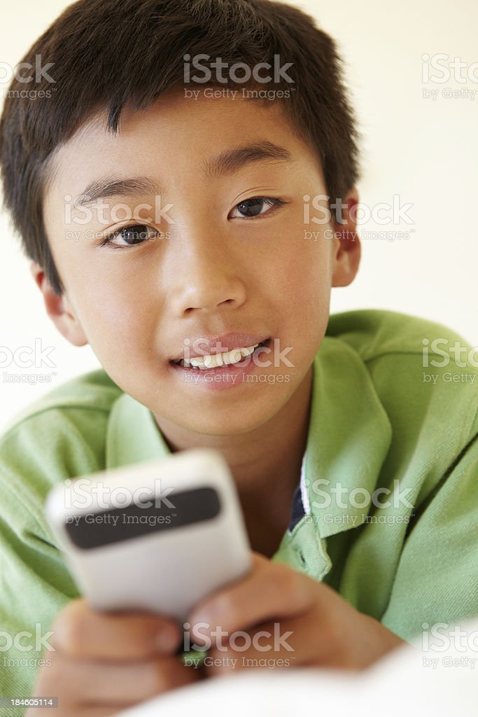 Young boy using smartphone royalty-free stock photo