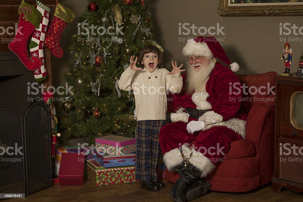 Young boy very excited to meet the real Santa stock photo