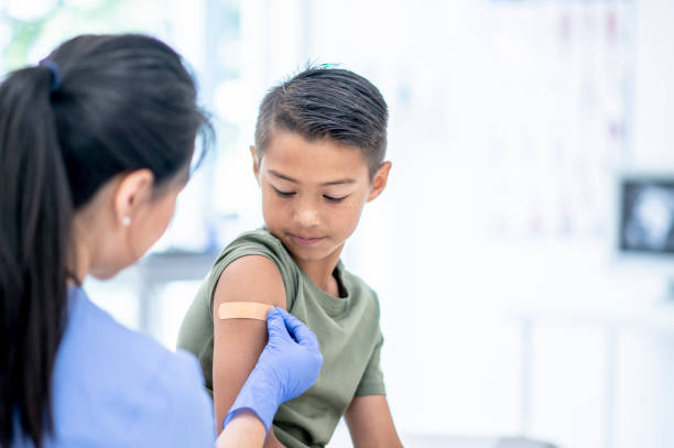 Young Boy Visits Doctor stock photo