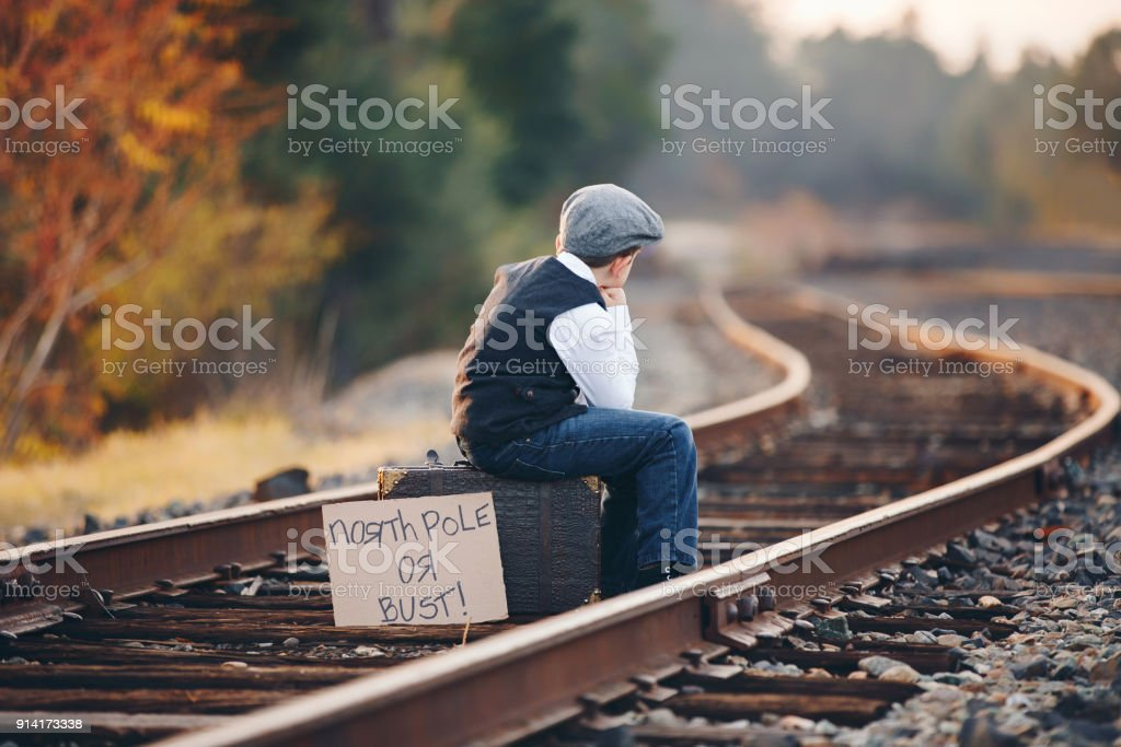Young Boy Waiting Patiently for Train to North Pole stock photo