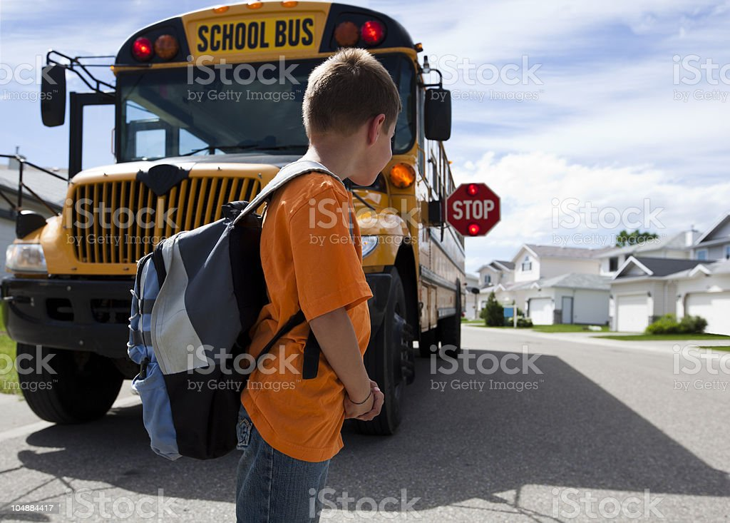 Young boy waiting to cross street royalty-free stock photo