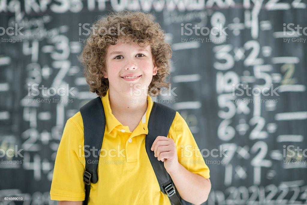 Young Boy Walking to Class stock photo