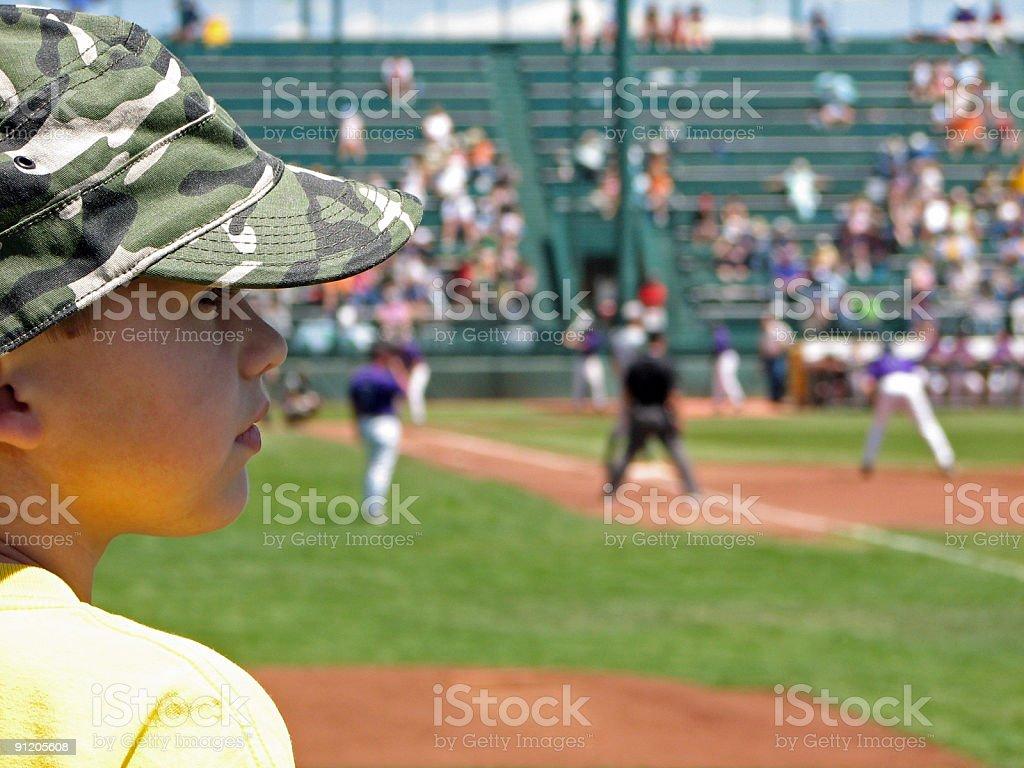 Young Boy Watching Baseball Game royalty-free stock photo