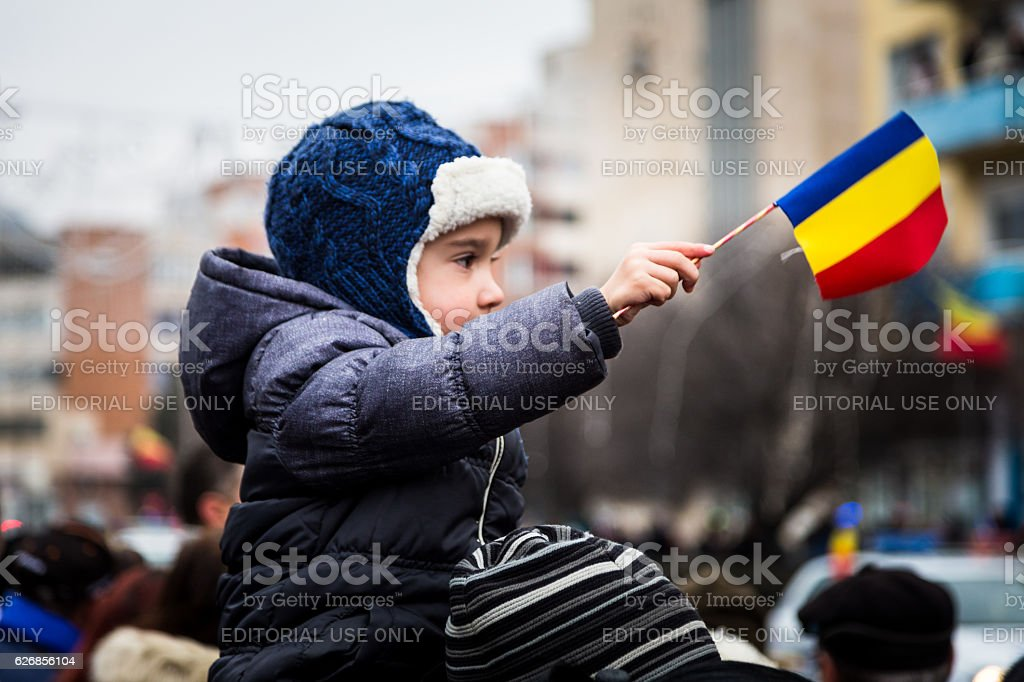 Young boy waving Romanian flag on Romania Unification Day stock photo
