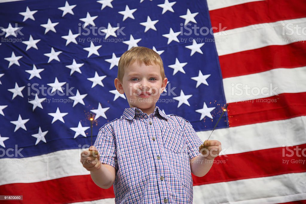 Young boy waving sparklers stock photo