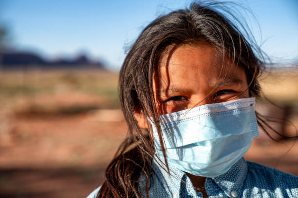 A Young Boy Wearing A Mask Over His Mouth And Nose Because Of The Coronavirus Pandemic On The Navajo Reservation In Arizona stock photo