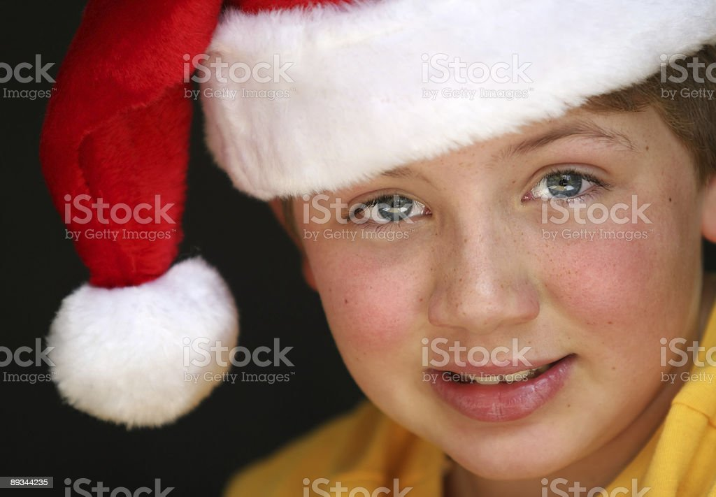 Young boy wearing a Santa hat close up royalty-free stock photo