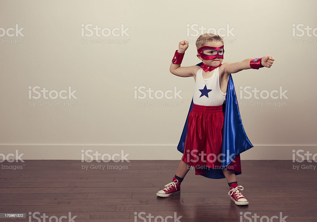 Young boy wearing a superhero costume royalty-free stock photo