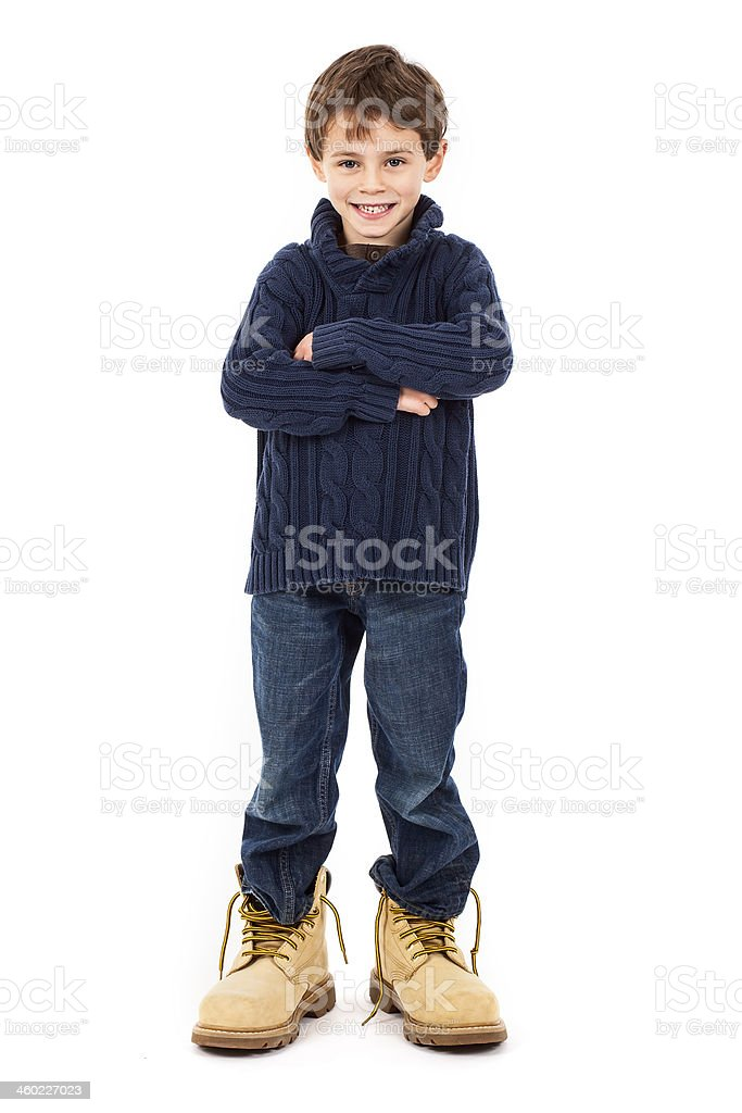 Young boy wearing big boots on white background stock photo